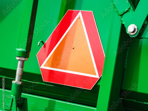 Obraz Warning triangle sign on agricultural machine - fototapety do salonu