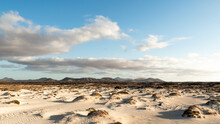 Sand Dunes, Mountains And Clou...