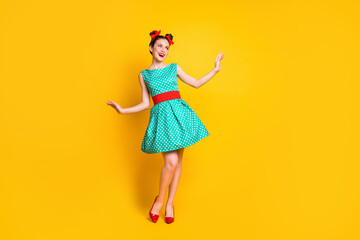 Full length body size view of nice charming cheerful girl wearing teal dress dancing posing isolated over bright yellow color background