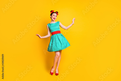 Obraz Full length body size view of nice charming cheerful girl wearing teal dress dancing posing isolated over bright yellow color background - fototapety do salonu