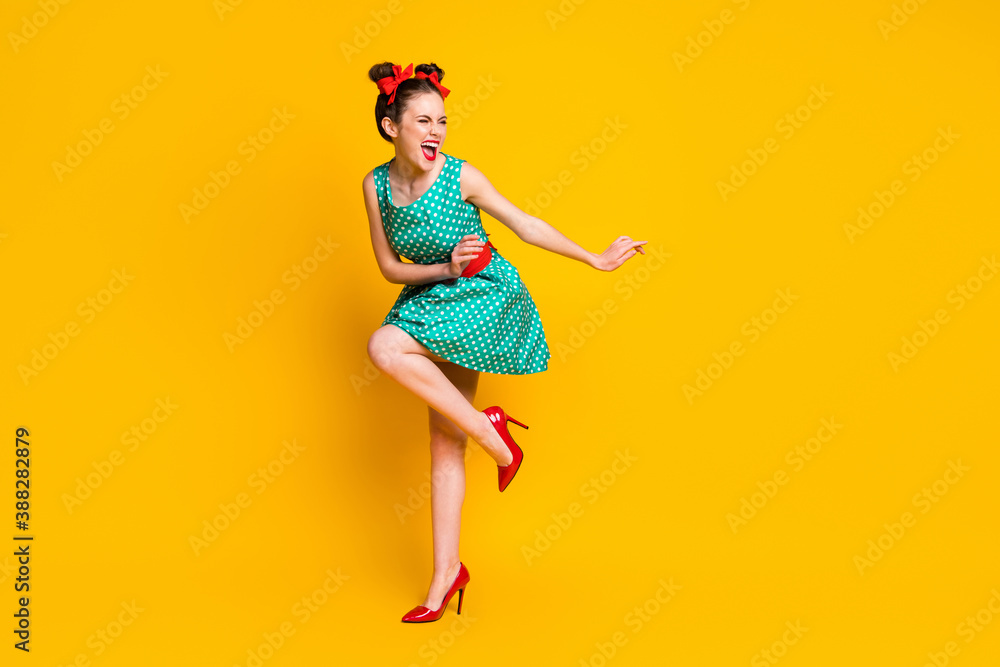 Fototapeta Full length body size view of lovely slim cheerful girl dancing disco having fun chill out isolated on bright yellow color background