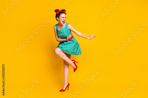 Obraz Full length body size view of lovely slim cheerful girl dancing disco having fun chill out isolated on bright yellow color background - fototapety do salonu