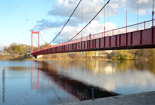 Fototapeta premium Russia Penza October 24, 2020: Druzhba suspension bridge on cables across the Sura river