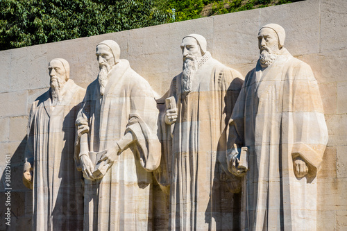 The four statues at the center of the Reformation Wall in the Parc des Bastions in Geneva, Switzerland, representing John Calvin and the Calvinism's main proponents, on a sunny summer day Canvas