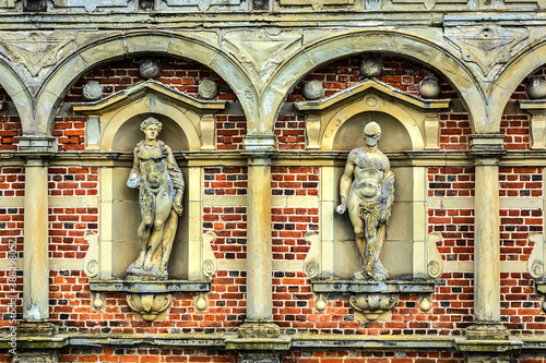 Impressive bricked wall and gorgeous decoration with sculptures at Frederiksborg Castle (Frederiksborg Slot, XVII century) - old royal residence for King Christian IV Fotobehang
