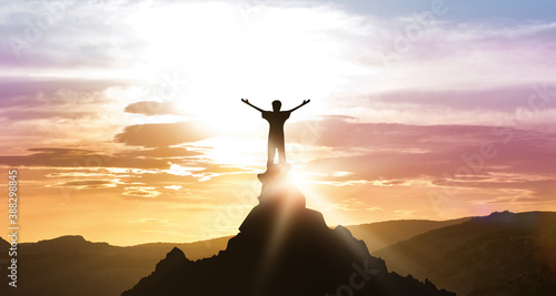 Man Standing On Top Of Mountain Looking At Daybreak Outdoors