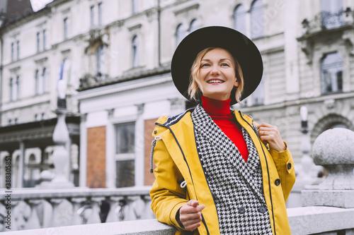 Obraz Street look of tourist woman in Ljubljana. Travel Slovenia, Europe. - fototapety do salonu