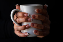 Woman's Hands Holding A Cup Of...