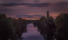 Distant Rowers On The River Wye At Dusk
