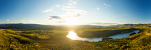 Beautiful View Of Scenic Valley From Above Alongside Winding River, Forest And Mountains At Sunset. Aerial Drone Shot. Taken Near Klondike Highway, Yukon, Canada.