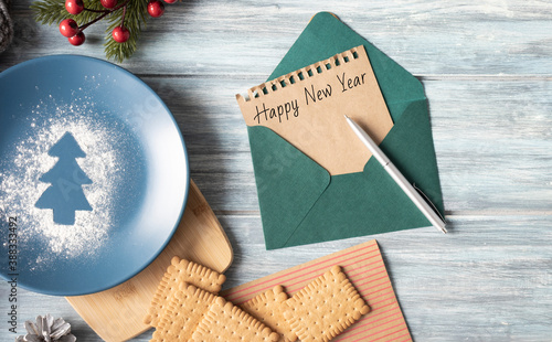Obraz na plátně Happy new year 2021 - clips on paper envelope with rope lie on wooden table