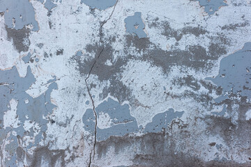 blue with dark blue old plaster texture on the street wall of the house