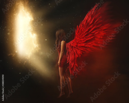 Fotografering Young beautiful angel woman with red wings travels, flies between worlds and universes through a space portal, shining gates