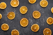 Dried Orange Slices On Gray Ba...