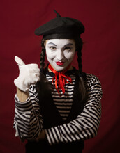 Beautiful Girl Mime Smiles, Shows Thumb Up.