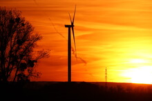 Wind Turbine And Red Sky At Sunset