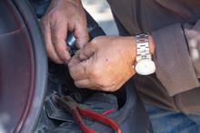 Mechanic Repairing A Car Backl...