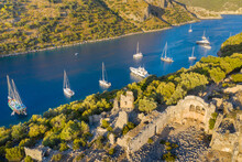 View To Sea Bay With Sailing Yachts Behind Saint Nickolas Island With Ruins Of Antique City In Sun Light In Turkey