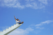 Woman Sitting On White Stair T...