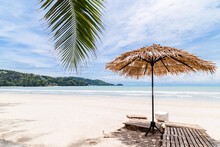 Beach Umbrella Made Of Palm Leafs On A Perfect White Beach In Front Of Sea, Thailand.