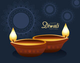happy diwali celebration with two candles wooden and lettering