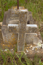 Damaged Grave Headstone With Cross