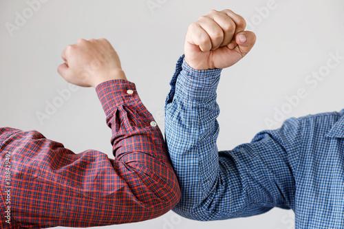 Obraz na plátně Two people Elbow bump