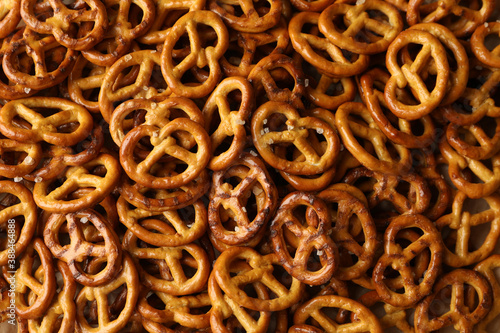 Tela Tasty salty cracker pretzels on whole background