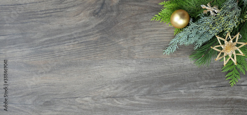 Obraz christmas decoration banner with branches and matte golden bauble and straw star decorations - copy space - fototapety do salonu