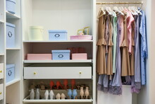 Hangers With Women's Dresses A...