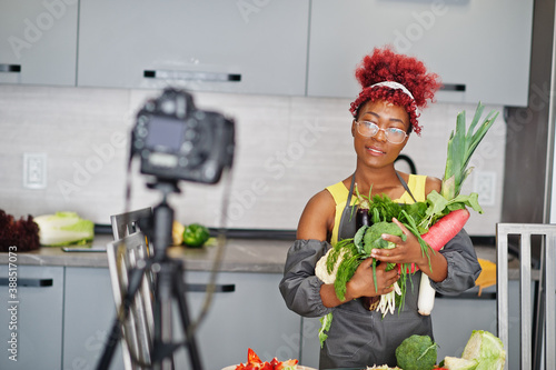 African american woman filming her blog broadcast about healthy food at home kitchen Fototapeta