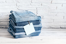 A Stack Of Blue Denim Pants Wi...