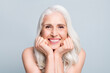 Leinwandbild Motiv Closeup photo of beautiful aged woman beaming toothy smile touch arms cheekbones isolated grey color background