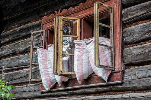 Fotografiet Pillows in the window, Orava village, Slovakia