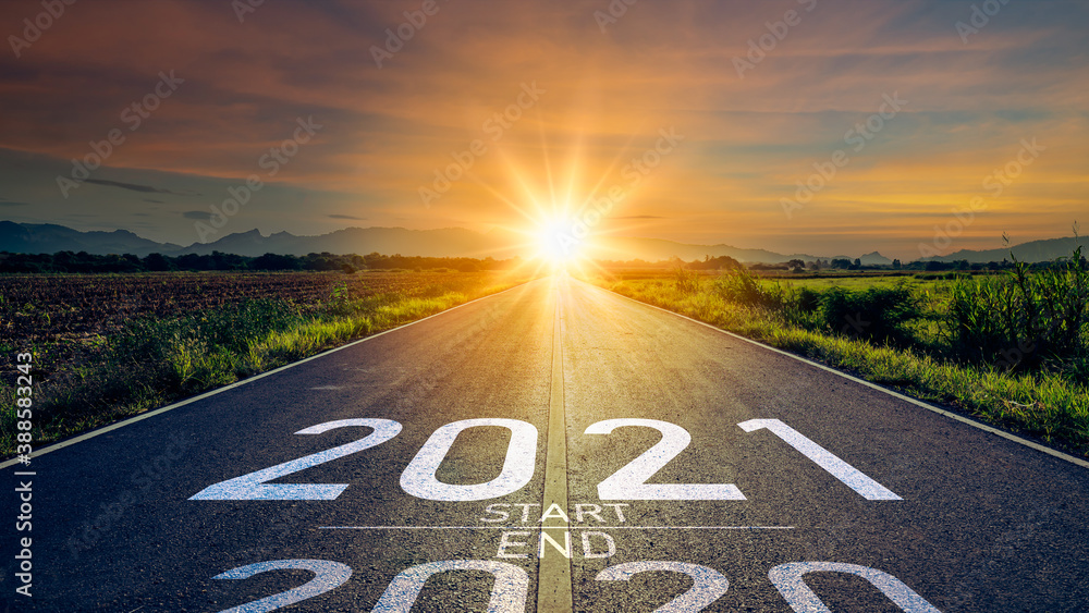 Fototapeta New year 2021 or start straight concept.word 2021 written on the road in the middle of asphalt road at sunset.Concept of planning and challenge or career path,business strategy,opportunity and change