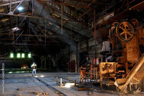 Male urban explorer in an abandoned brickmaking factory Fotobehang