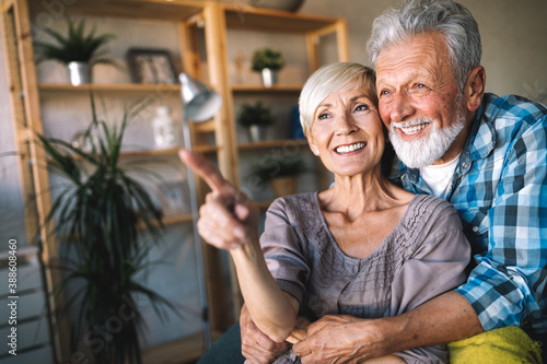 Fotografia Happy senior couple in love hugging and bonding with true emotions at home