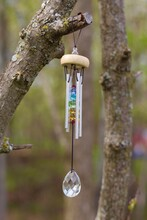 Wind Chime With Chakra Stones Hangs From Tree