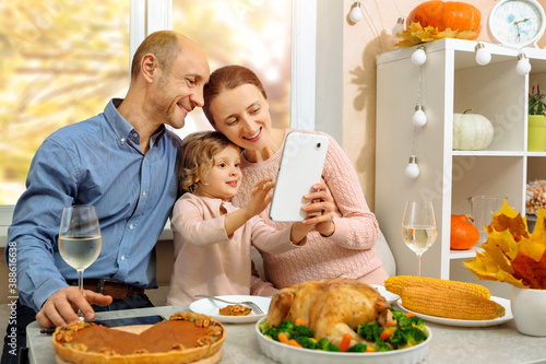 A happy family have a thanksgiving dinner and sends a video greeting to their parents Canvas Print