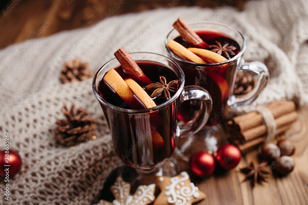 Fototapeta Christmas hot mulled wine with spices and orange