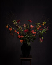 Studio Still Life Of Bouquet Of Autumn Flowers In Vase In Classic Dark Rembrandt Style