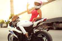 Slender Sexy Girl Posing On A Sports Bike