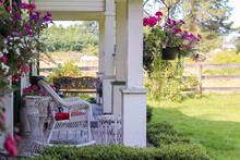 Beautiful Decorative Gazebo Terrace With Flowers In A Countryside. Selective Focus, Travel Photo, Street Photo, Nobody.