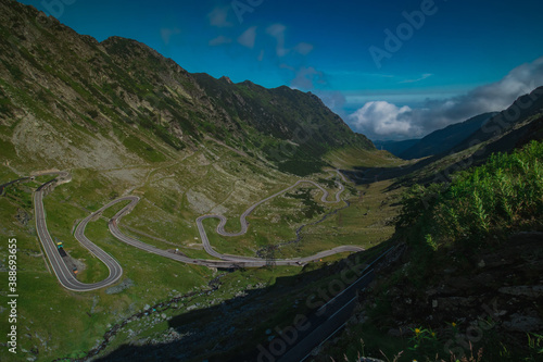Canvas Epic winding road on Transfagarasan pass in Romania in summer time, with twisty road rising up