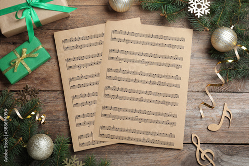 Obraz Flat lay composition with Christmas music sheets on wooden background - fototapety do salonu