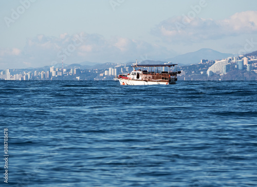 Fotografie, Obraz Passenger ship or steam boat on sea voyage at Sochi coastline background at sunn