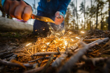 Man Outdoors Makeing Fire By F...