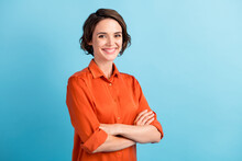 Photo Of Pretty Attractive Lady Bobbed Hairdo Arms Crossed Self-confident Person Worker Friendly Smile White Teeth Good Mood Wear Orange Office Shirt Isolated Blue Color Background