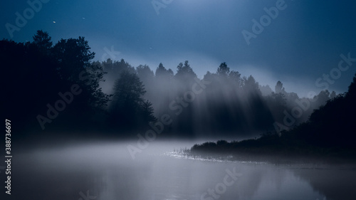 Valokuvatapetti Mist over the river, moonlit night, fog
