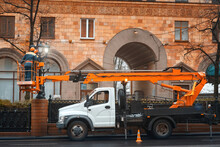 Aerial Platform Truck, Repair And Maintenance Of Street Lamps, Electricians Replace Led Light Bulb. Workers In Cherry Picker Repairing Street Lights. Men Working In Lift Bucket